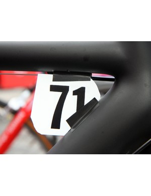 Katusha team mechanics mounted the race numbers with just a few strips of electrical tape