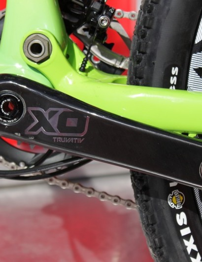 The silver X0 graphics are actually a metallic decal that's laid under the clear coat of the crank's finish