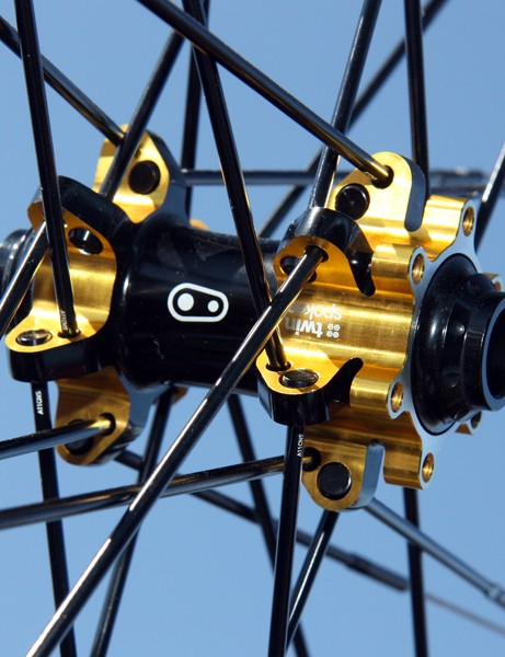 Love it or hate it, the new CrankBrothers Cobalt 11 hubs get an eye-catching black and gold anodized finish. Front hubs are convertible between 9mm and 15mm standards
