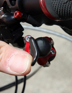 Push the paddle on the flat part and the derailleur will move in one direction - push on the lower edge first and it'll move in the other direction