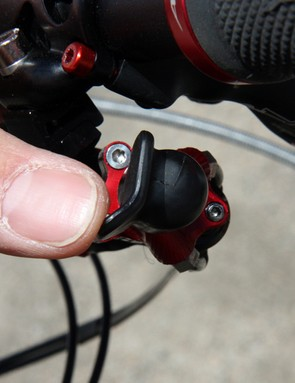 The direction of derailleur movement is determined by where you push on the pivoting shift paddle end