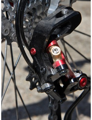 The rear derailleur is adjusted via two conventional limit screws while the hydraulic piston position is tweaked with a small set screw