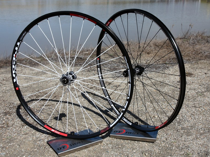 DT Swiss finally have a high-end alloy 29in wheel option for 2012 in the new Tricon XM1550 29er (left). Riders on a tighter budget can instead look to the M1800 29er (right), which is still tubeless and uses a star ratchet hub but adds some weight and does without the crow's foot spoke lacing