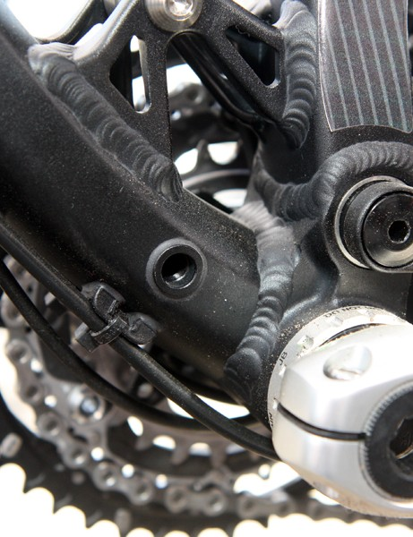 The main pivot bearings on the new Norco Sight are pressed directly into the one-piece forged bottom bracket assembly. Note the storage point for the spare derailleur hanger bolt