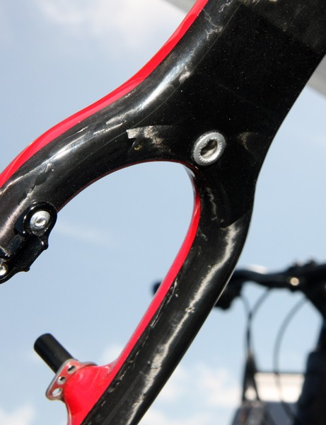 A rivnut is installed on the backside of the seatstay wishbone on the new Norco Threshold for mounting fenders.  Note the zip-tie attachment for the rear derailleur housing, which runs uninterrupted from the top tube to the derailleur