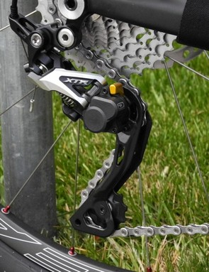The Shadow Plus derailleur features an on-off switch for the lower pulley cage's friction ratchet
