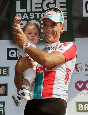 Philippe Gilbert (Omega Pharma-Lotto) and son on the podium
