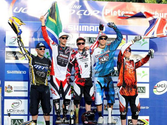 American Aaron Gwin (centre) celebrates his triumph in the elite men's downhill at Pietermaritzburg