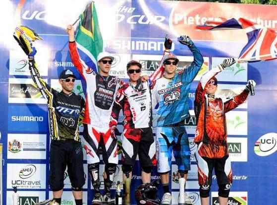 American Aaron Gwin (centre) celebrates his triumph in the elite men's downhill at Pietermaritzburg
