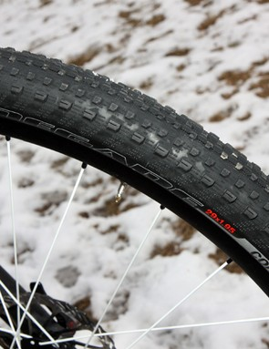 The Specialized Renegade tire is extremely fast rolling and very grippy on hardpack and bare rock.  The relative hard 65a rubber compound wears pretty well, too