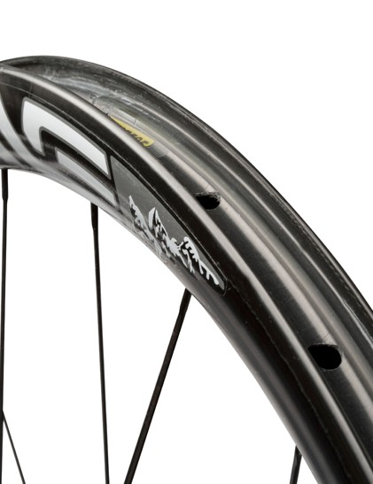 The ENVE rim's pierced outer wall requires the use of an airtight rim strip in order to be run tubeless