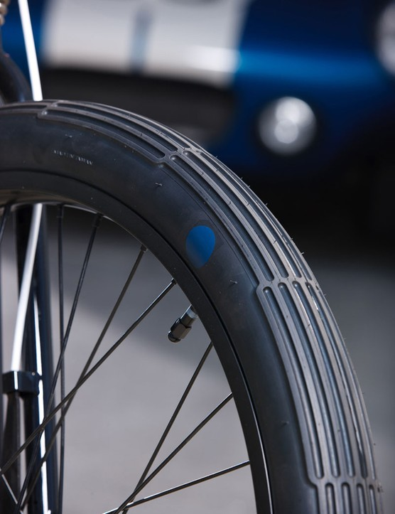 "The bike rolls on 36 spoke wheels wrapped with ""blue dot"" tyres to resemble motor racing tyres"