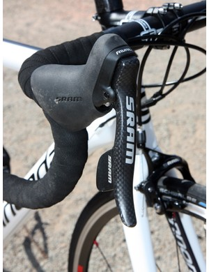 The SRAM Rival DoubleTap levers use nearly identical internals to the top-end Red group and is one of the best performance values currently on the market.  Unfortunately, their function is slightly hampered in this case by so-so cables and housing that have too much friction