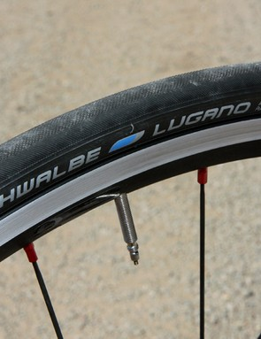 The stock Schwalbe Lugano tires grip reasonably well but are saddled with unusually high rolling resistance
