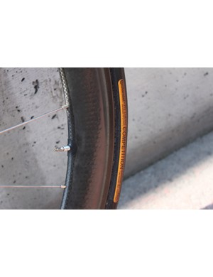 Continental's 22mm Pro Limited Competition tires are glued to the custom built wheels