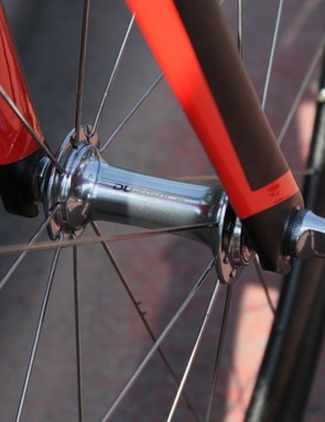 The front wheel is laced radially with 18 spokes