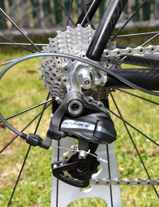 The Shimano Dura-Ace rear derailleur is bolted to a replaceable aluminum hanger.