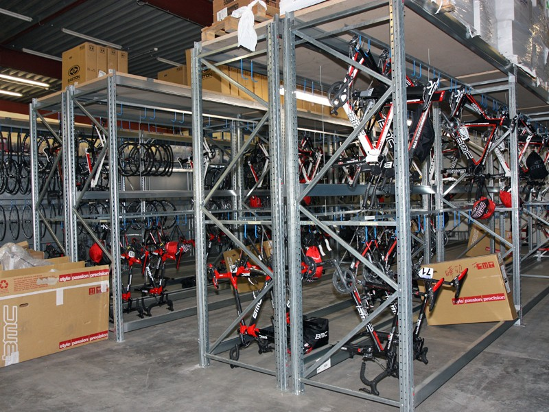Double-height racks are used to store BMC's team bikes in the service course. Bikes are stored without wheels attached since those can vary so much from one event to the next