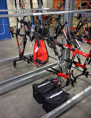 Team bikes are generally organized by rider, with each getting their own section in the racks