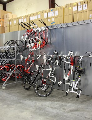 This corner of the service course included a rack for discontinued bikes and framesets, and a portable rack specifically for time trial wheels. Tucked behind the wall is the storage area for new components, while sitting up top is an army of new wheels and tires