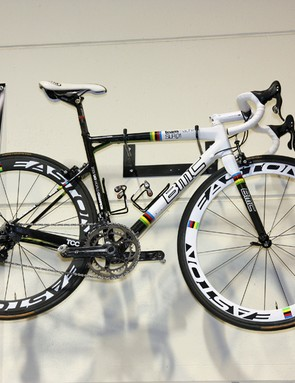 The mechanics' area of the BMC service course is decorated with one of Cadel Evans' world championship bikes on one side of a big banner…
