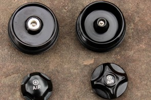 Looking at the underside of the old four-piece air cap (right) and new three-piece air cap (left)