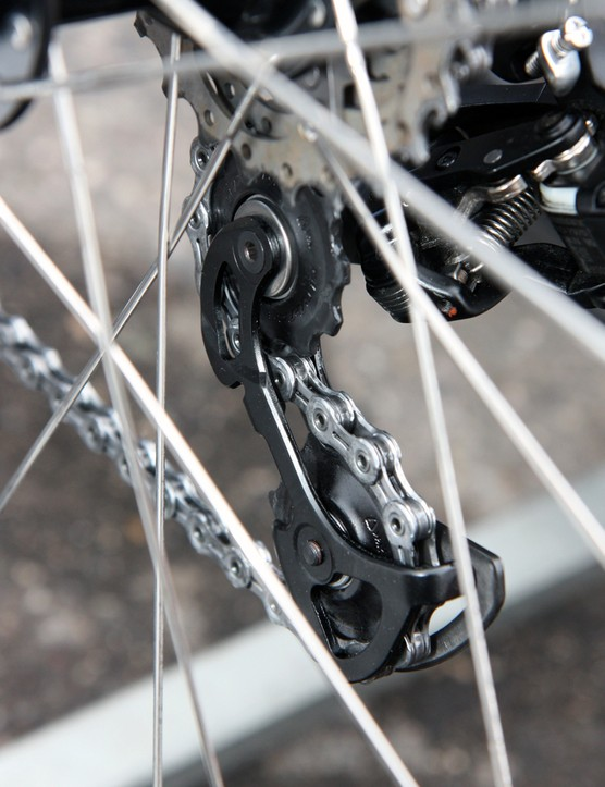 …but flip around to the other side and you can see that the standard carbon fiber inner pulley cage plates have been replaced with stouter aluminum ones
