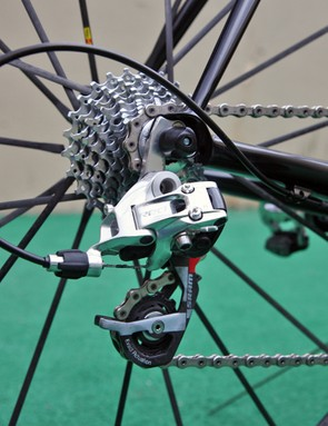 The SRAM Red rear derailleur is bolted to a replaceable aluminum hanger