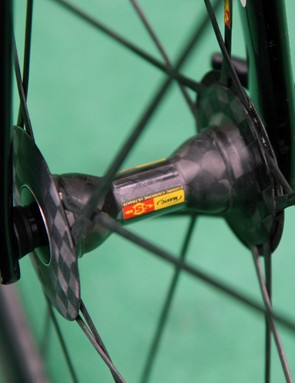 The sleek Mavic Cosmic Carbone front hub uses an all-carbon shell