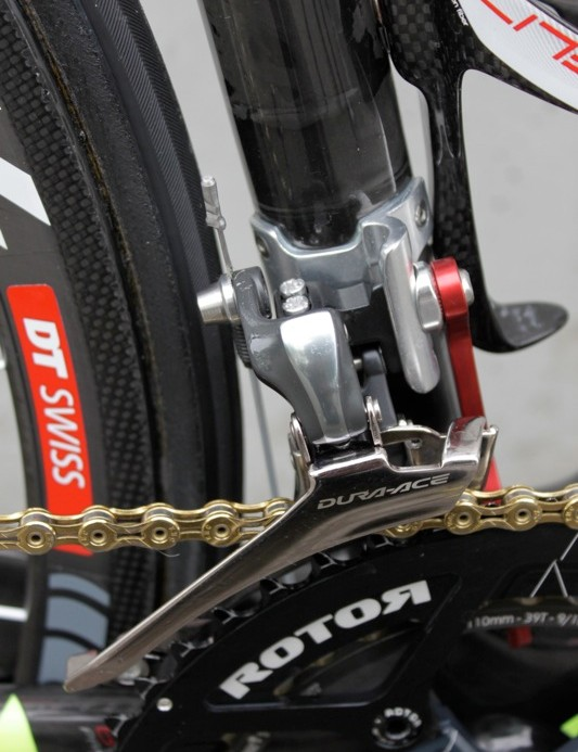 Shimano's 7900 front derailleur mounts to an alloy braze-on that's bonded and riveted to the carbon seat tube
