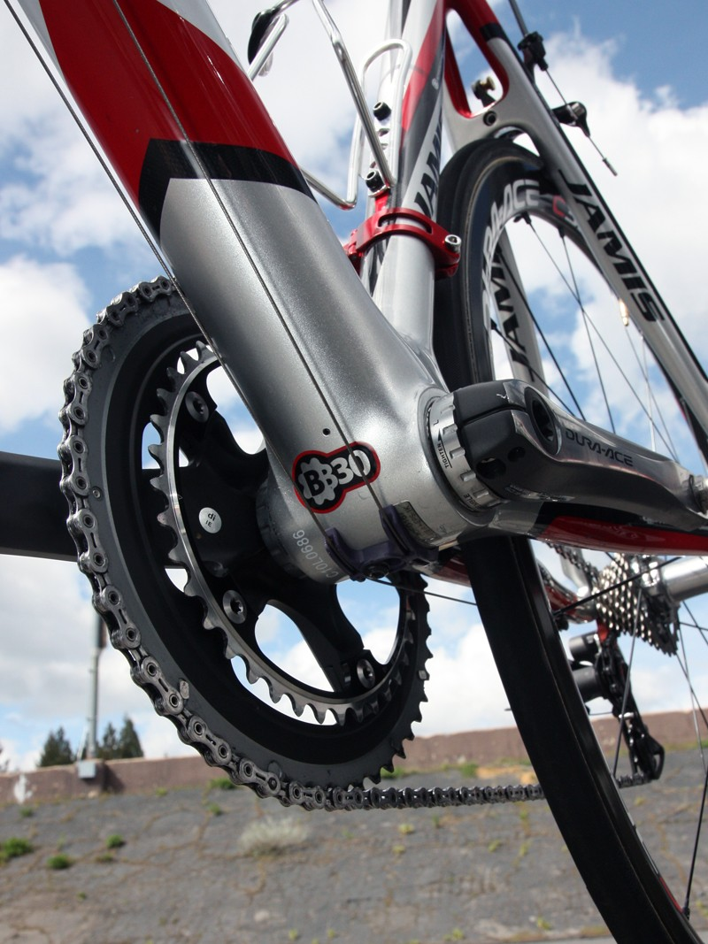 Jamis Xenith SL frames use BB30-compatible bottom bracket shells but as the team are sponsored by Shimano - who still don't offer a proper BB30 crankset - they have to add threaded shell adapters