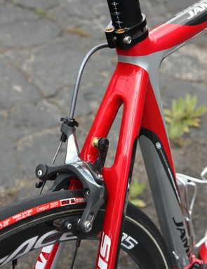 Jamis Sutter Home team bikes are fitted with neat carbon fiber number holders with nicely machined brass thumbwheels for easy plate installation and removal