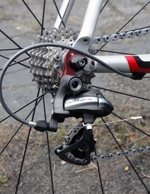 The Shimano Dura-Ace rear derailleur is bolted to a red anodized replaceable alloy hanger