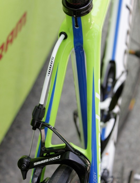 The rear brake cable exits the back of the top tube; the housing must be precisely cut to keep the brake centered