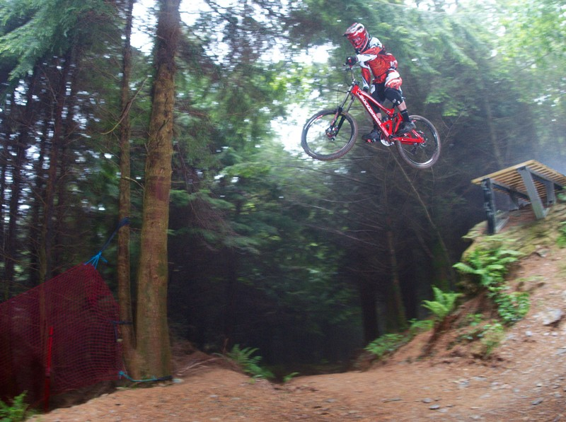 MBUK's Rob Weaver takes on the ladder jump on Gawton's Super Tavi trail on his Mondraker Summum long-term test bike