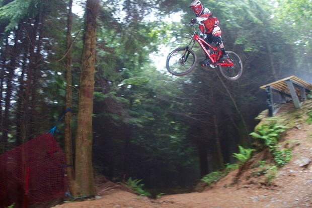 MBUK's Rob Weaver takes on the ladder jump on Gawton's Super Tavi trail on his Mondraker Summum long-term test bike