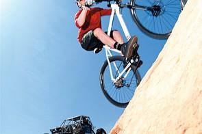 Mountain biker vs rock crawler 4x4 in Moab