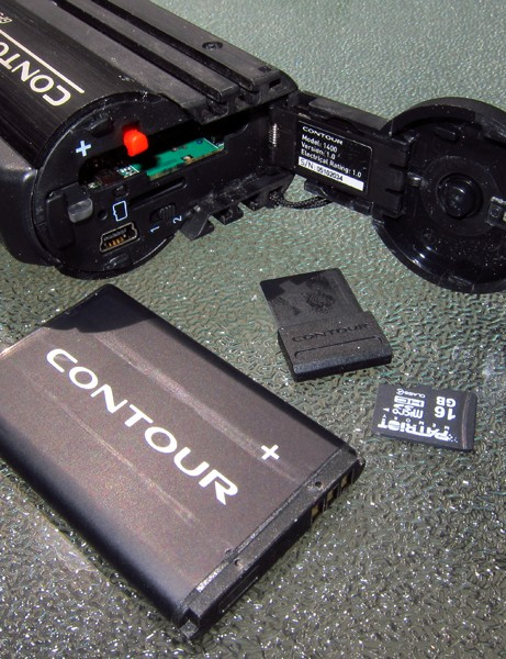 The newly hinged and spring-loaded door on the ContourGPS conceals a lot of hardware, including a Li-ion battery, Connect View Bluetooth card, and MicroSD card, not to mention the mini-USB port and two-position video mode switch