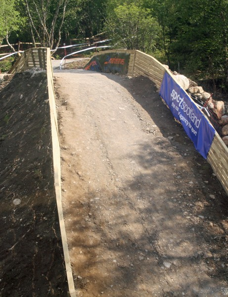Riders enter the 'Puggy Pipe' blind, with no view of the downslope