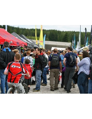 The pits were crowded with people checking out the pros' bikes and shopping for new gear