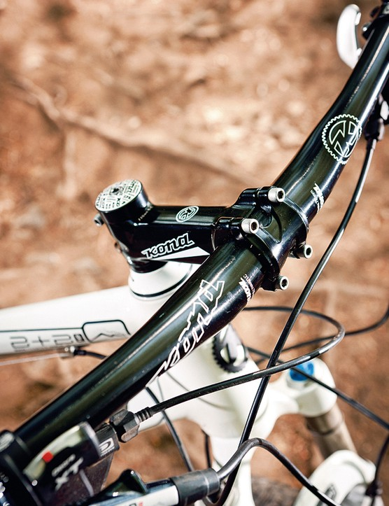 The Kona seat post, bar and stem are fine if not fancy