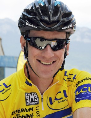 Brad Wiggins smiles in the yellow jersey before the final stage