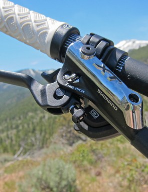The sleek new Shimano Deore XT brake levers are near carbon copies of the XTR Trail flagship with similar one-finger lever blades, Servo Wave variable leverage ratios, and a revamped pivot architecture that feels more natural in your hands
