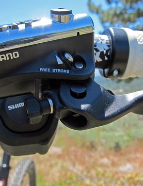 Reach is adjusted via the handy knob on Shimano's new Deore XT brake levers while pad contact point is unfortunately still tweaked via a small Phillips-head screw