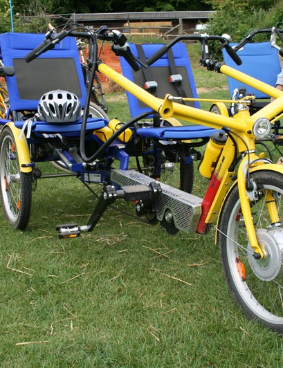 The side by side tandems are motor-assisted and suited for people with leaning disabilities who may not be able to fully control their own bike
