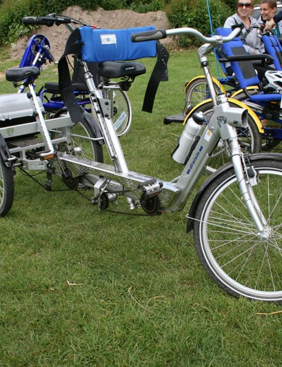 Three-wheeled tandems allow people with vision or other sensory impairments to experience cycling