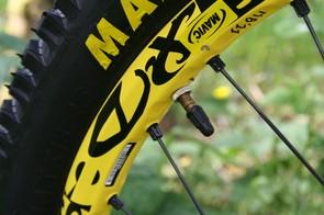Marc Beaumont's wheels have two valve caps - one black...