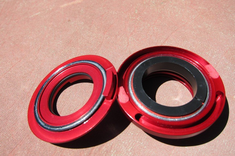 The top bearing race of the BlockLock headset features a groove with elastomer bumpers in which a key on the top cap runs limiting travel to 176-degrees