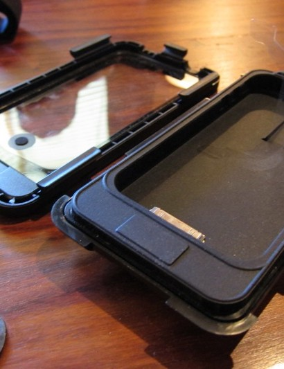 The case features a rubber lined cradle and 6-latch touch through clear cover