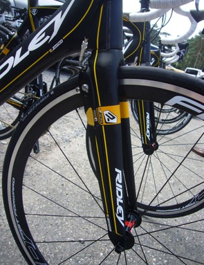 The front brake is both integrated and set behind the fork